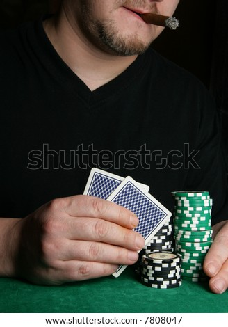 Hands of card-player and space for your text above - stock photo