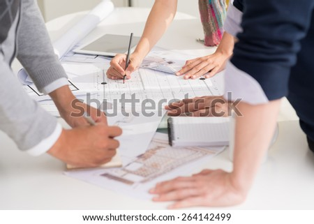 Hands of designers planning interior of the house, selective focus