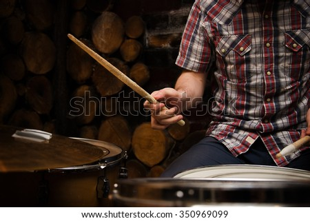 Hands of drummer with sticks and drums close-up - stock photo