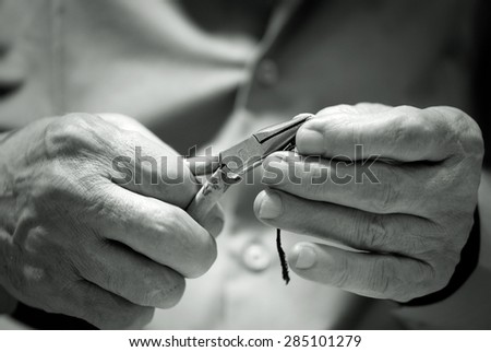 Hands of elderly man  in a black and white