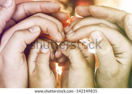 hands of  family in  conceptual position. - stock photo