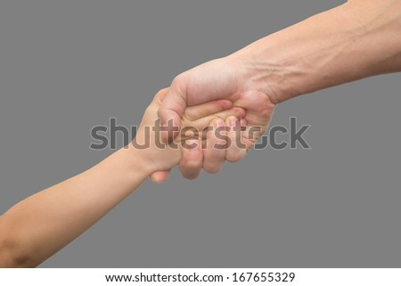 hands of father and son on a gray background - stock photo