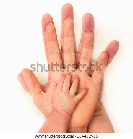 Hands of father, mother, and child  - stock photo