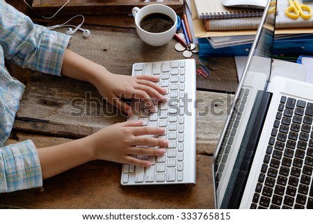 Hands of female typing. - stock photo
