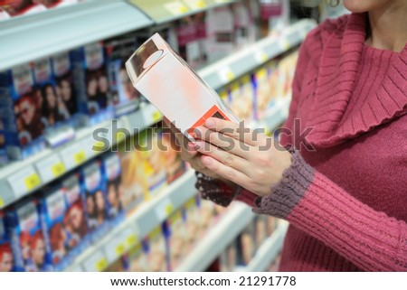 Hands of girl in store with box - stock photo