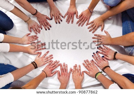 hands of girls form a circle - stock photo