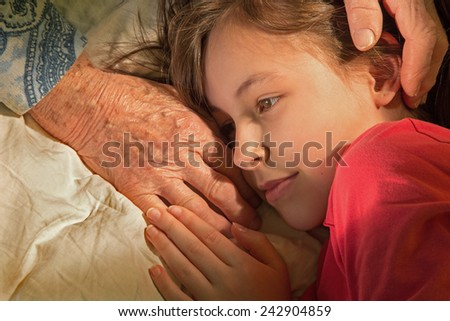 hands of grandmother and granddaughter in the morning - stock photo
