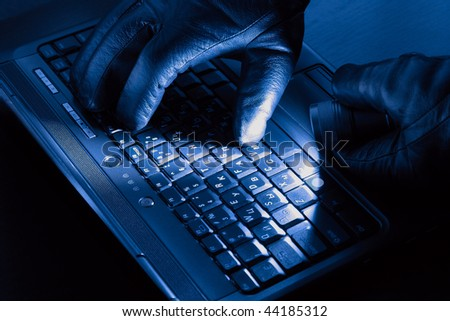 Hands of hacker on a laptop - stock photo