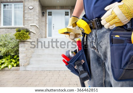 Hands of Handyman with a tool belt.