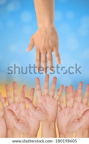 hands of help over bright background - stock photo