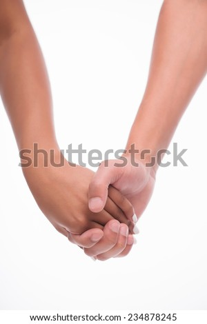 Hands of man and woman getting together. Isolated on white background - stock photo