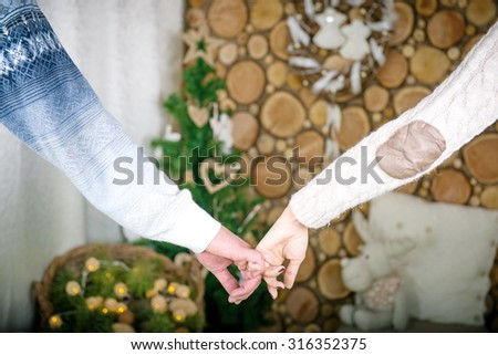Hands of man and woman holding together. two hands together - stock photo