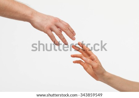 Hands of man and woman holding together, white background