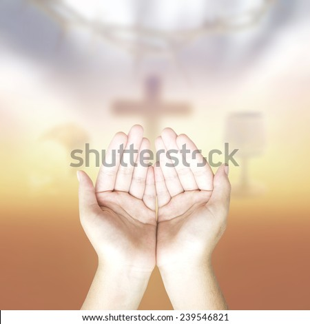 Hands of man praying on glass of wine and Loaf of bread with crown of thorns and the cross on a sunset in eucharist. Worship, Forgiveness, Repentance, Adoration, Glorify, Maundy Thursday concept. - stock photo