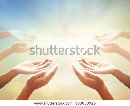 Hands of man praying over blurred crown of thorns and the cross on a sunset. Thanksgiving, Christmas, Health Care, Worship, Forgiveness, Repentance, Reconcile, Adoration, Glorify, Redeemer concept. - stock photo