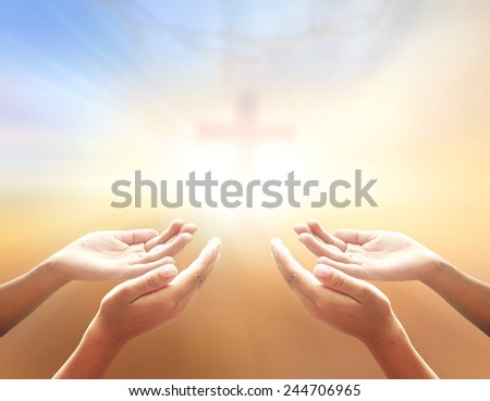 Hands of man praying over blurred crown of thorns and the cross on a sunset. Worship, Forgiveness, Mercy, Humble, Repentance, Reconcile, Adoration, Glorify, Redeemer concept. - stock photo