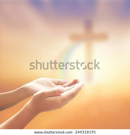 Hands of man praying over blurred the cross on a autumn sunset background. Forgiveness Mercy Humble Evangelical Hallelujah Thankful Redeemer Amen Pray Hope Merry Christmas concept. - stock photo