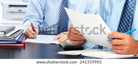 Hands of man with paper sheet. Accounting. - stock photo