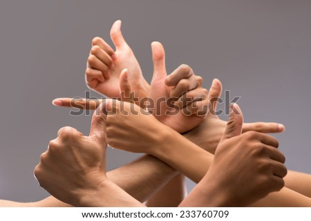 Hands of many people showing thumbs up - stock photo