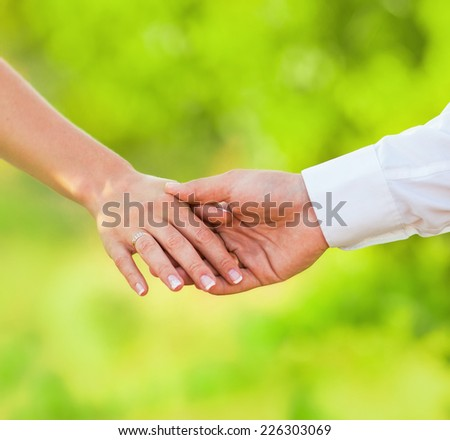 Hands of married man and woman - stock photo