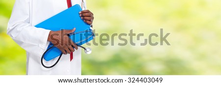 Hands of medical doctor with clipboard. Health care background. - stock photo