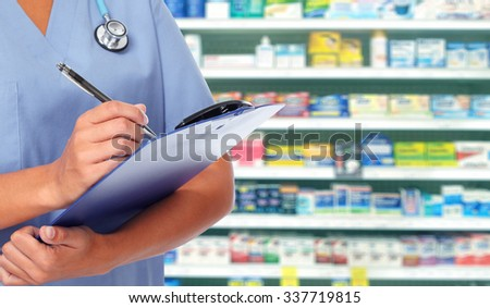 Hands of medical doctor woman writing on a clipboard.  - stock photo
