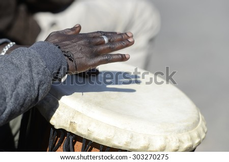 hands of musician playing the tomtoms, space for text - stock photo