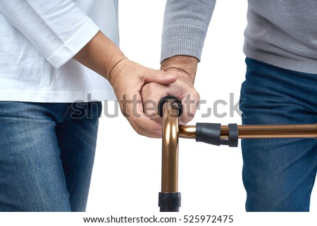 Hands of Nurse to senior patient with walker, isolated