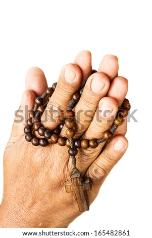 hands of old aged human were binded by wood rosary on white background (isolated)
