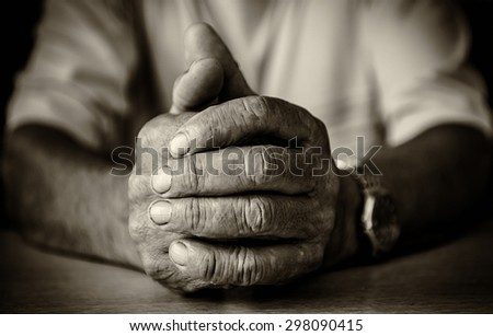 Hands of old man - stock photo