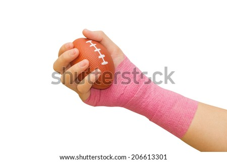 Hands of patient woman squeezing a stress ball  - stock photo