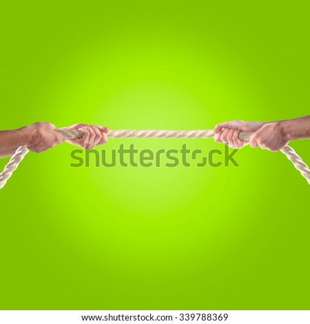 Hands of people pulling the rope. Competition concept - stock photo