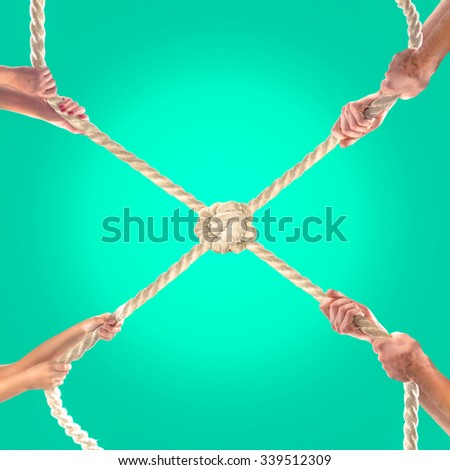 Hands of people pulling the rope on a green background. Competition concept