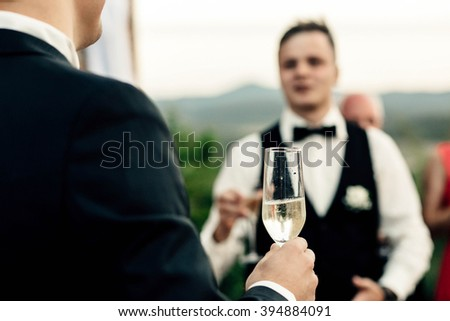 Hands of people with glasses of champagne or wine