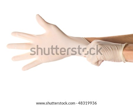 Hands of person putting on a medical glove isolated on white - stock photo
