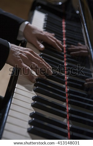 Hands of pianist playing playing