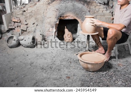 Hands of potter do a clay pot for make earthenware - stock photo