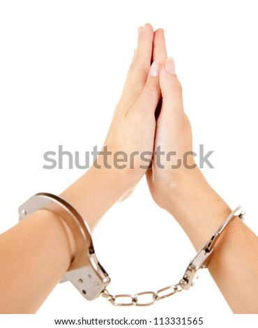 hands of praying woman with handcuffs, white background - stock photo