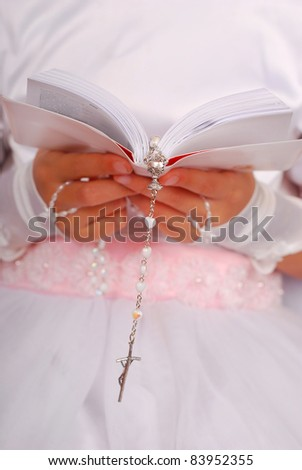 hands of prying girl going to the first holy communion - stock photo