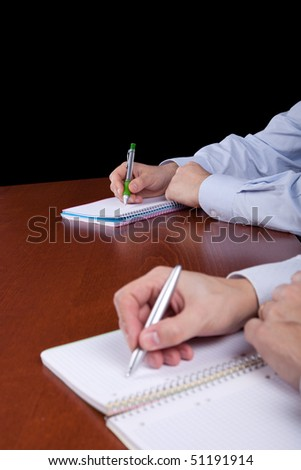 hands of some businessman meeting (focus at the hands in the background) - stock photo