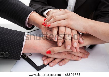 Hands of team members expressing unity