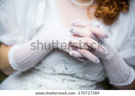 Hands of the bride while praying - stock photo