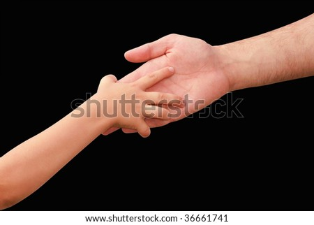 hands of the child and adult - stock photo