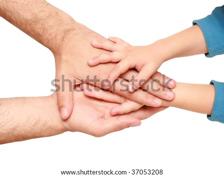 hands of the child in the hands of an adult male - stock photo
