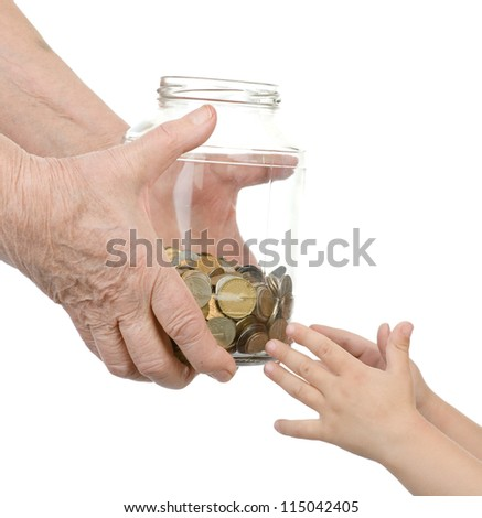 hands of the elderly person hand over to glass jar with coins in hands of the child. isolated on white background - stock photo