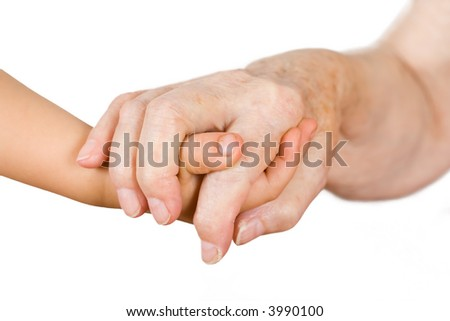 Hands of the girl and the grandmother on an isolated background - stock photo