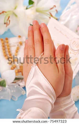 hands of the girl going to the First Holy Communion set in amen and  praying - stock photo