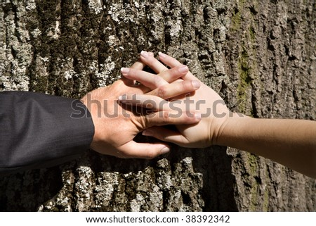 hands of the husband and fiance - stock photo