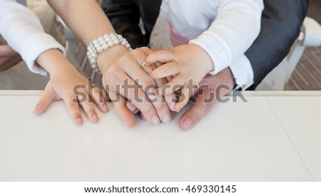Hands of the newlyweds and the little children / wedding / family