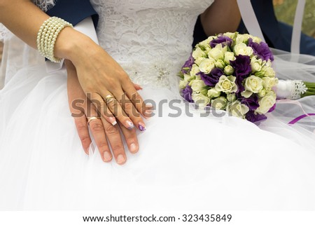 Hands of the newlyweds with rings
